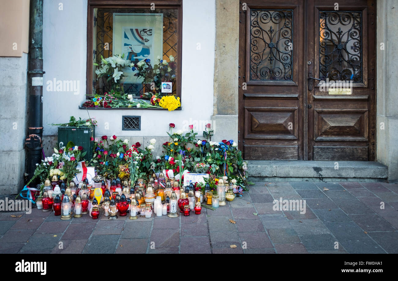 Flowers of Condolence, expressing sorrow, respect and and grief outside the French Consulate in Krakow, Lesser Poland - Stock Image