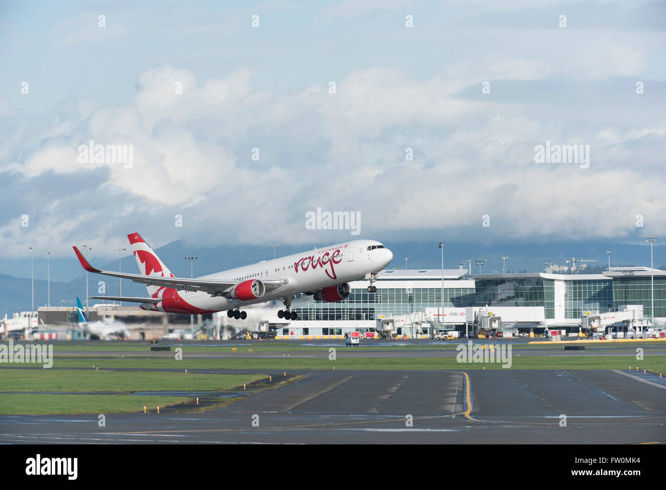Air Canada Rouge Boeing 767-300 in air after take off from YVR Vancouver  International Airport Stock Photo