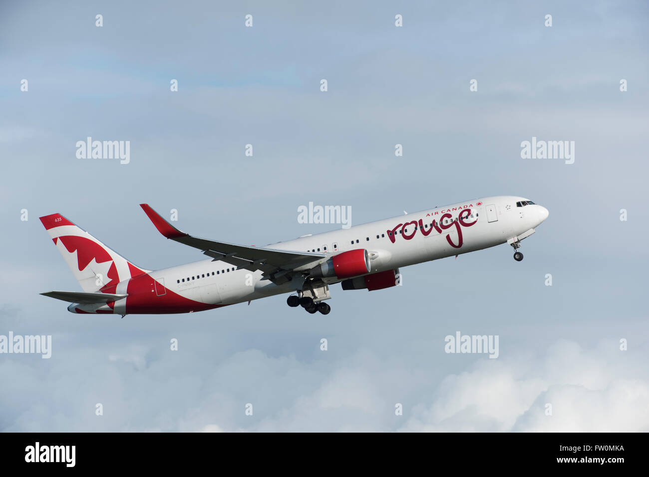 Air Canada Rouge Boeing 767-300 in air after take off from Vancouver International Airport Stock Photo