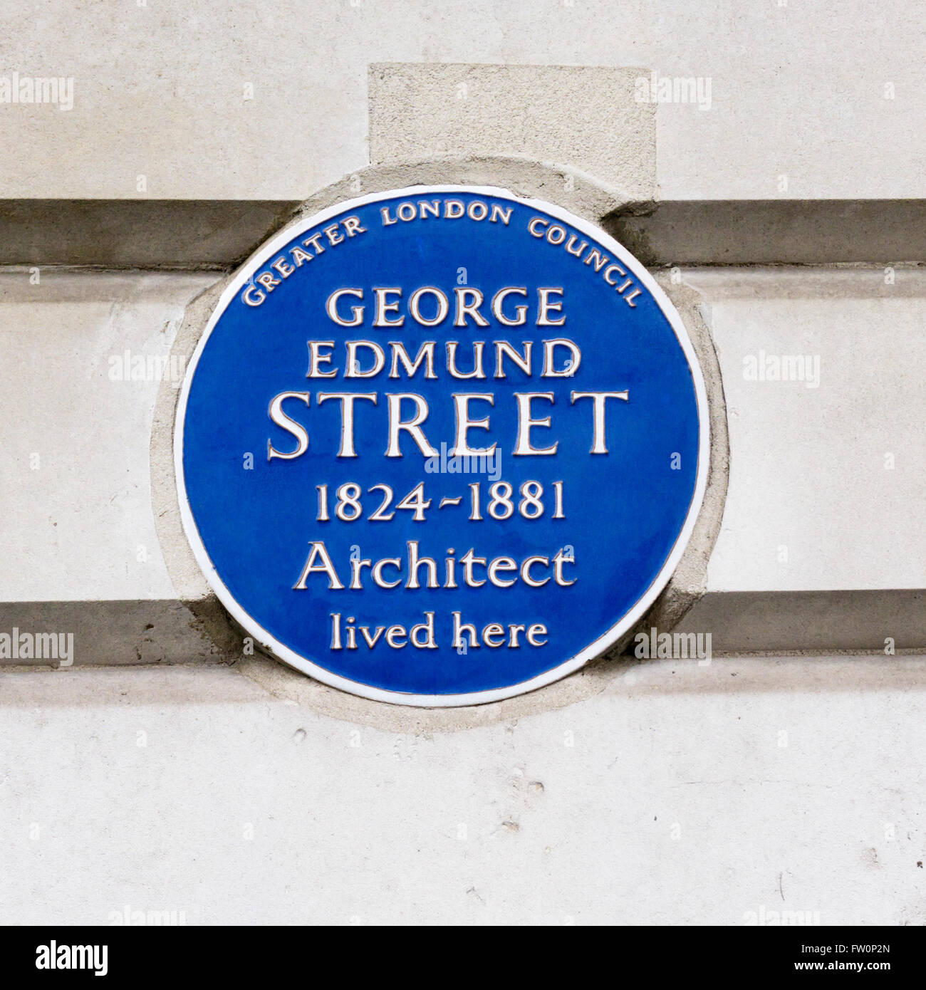 Blue plaque on the home of the architect George Edmund Street in Cavendish Place, London. Stock Photo