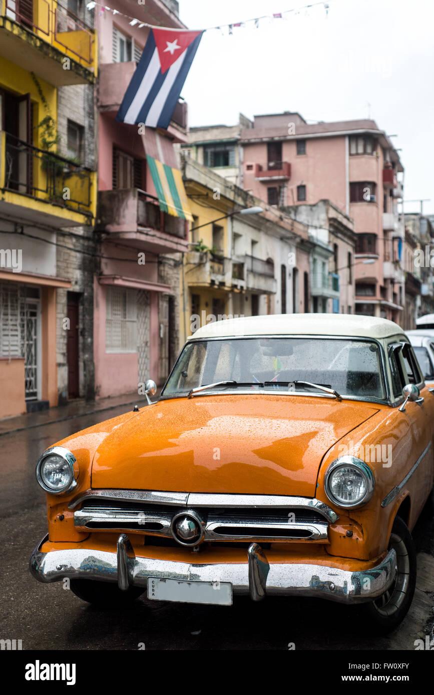 Street scene with old car on rainy day in Havana,Cuba Stock Photo ...