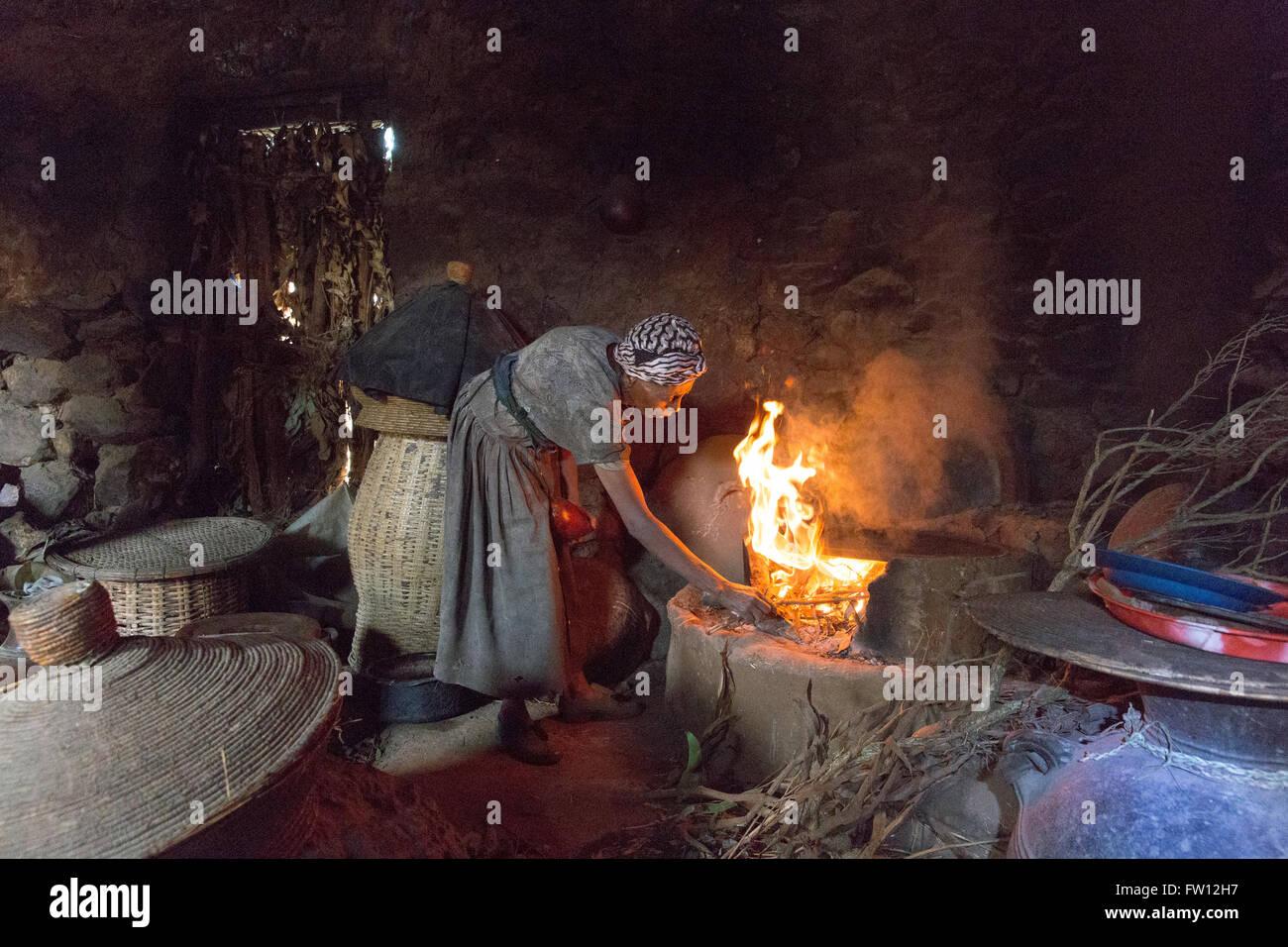 Debre Birhan, Amhara, Ethiopia, October 2013 Getachew's wife, Demekech, 68, prepares to cook on the fuel efficient - Stock Image