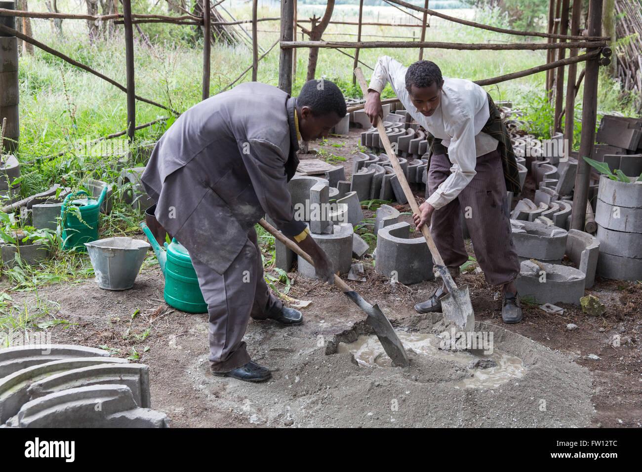 Debre Birhan, Amhara, Ethiopia, October 2013 Two young men making fuel efficient stoves at the EWNHS tree nursery. - Stock Image