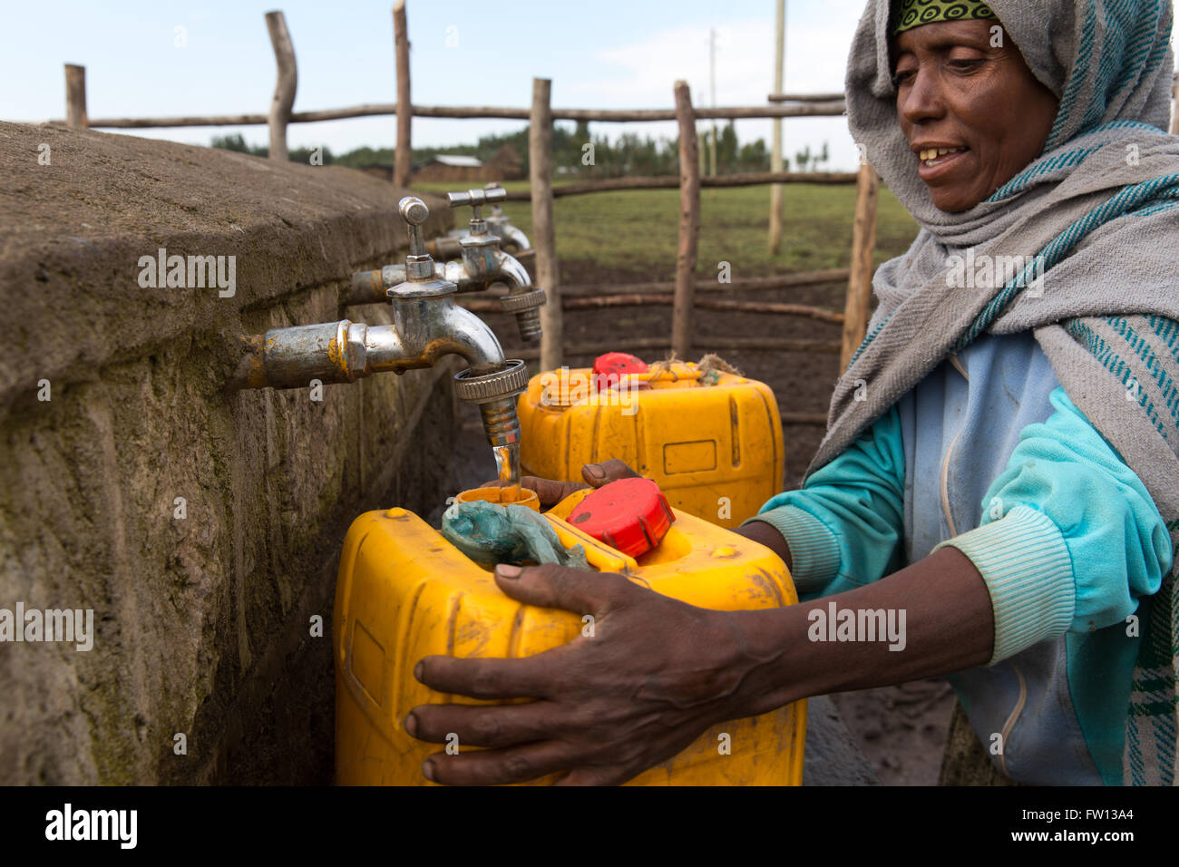 Debre Birhan, Amhara, Ethiopia, October 2013:  Ayelech Segni, 40, fetches water four times a day from this water - Stock Image