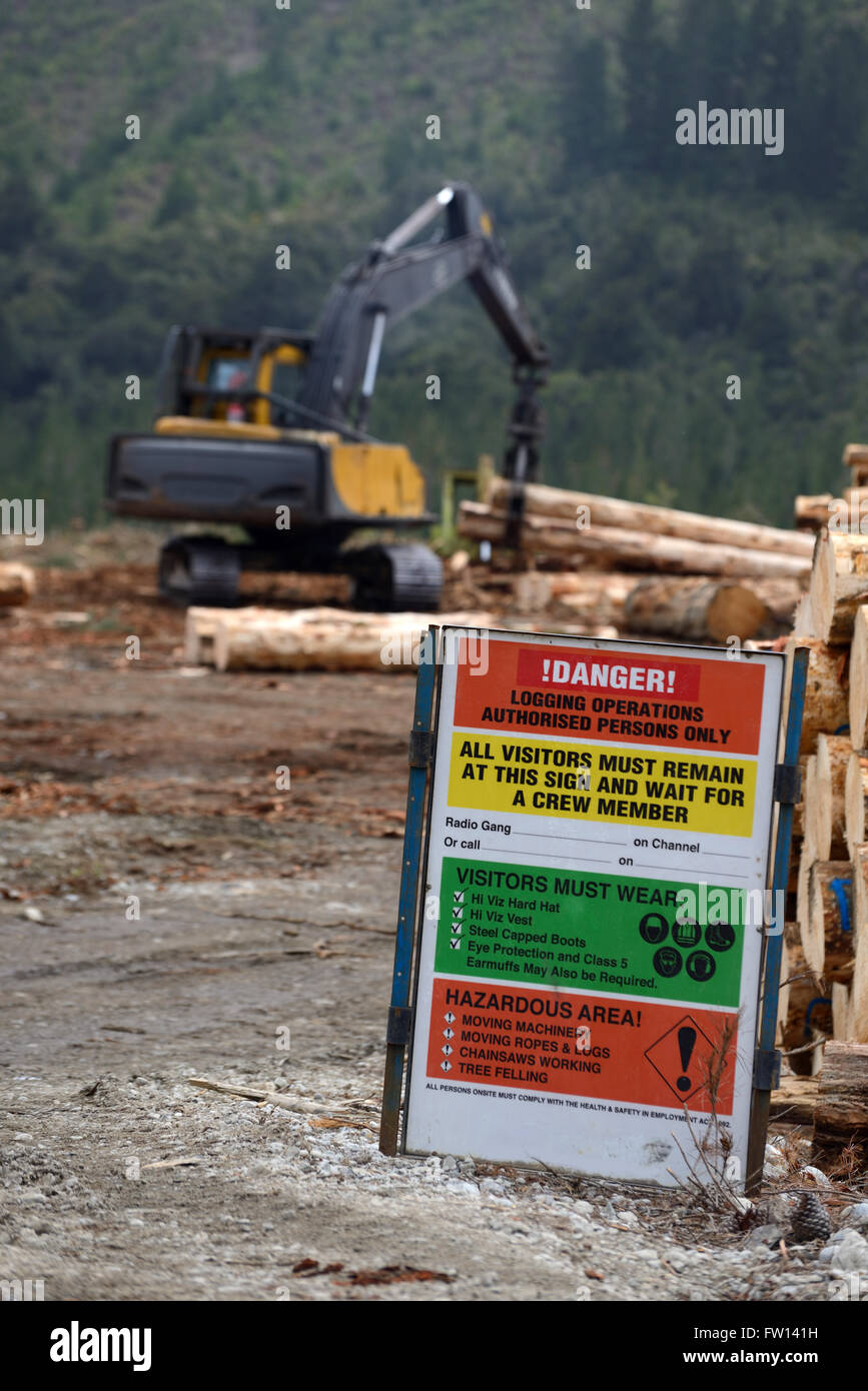 Safety signage warns of the dangers at a logging site on the West Coast - Stock Image