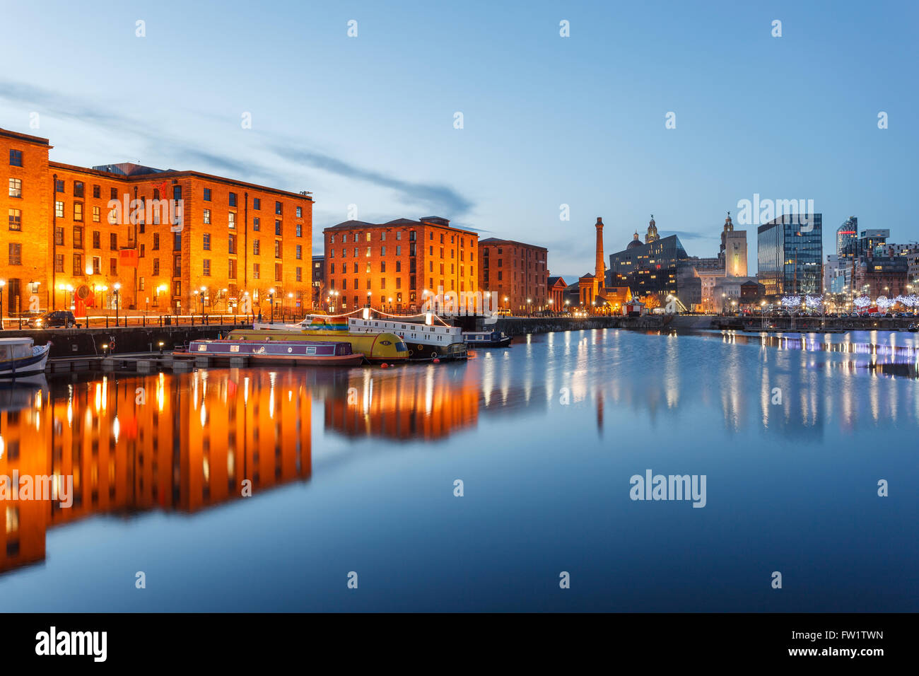 Reflections of old buildings at Albert Dock, Liverpool waterfront, UK. - Stock Image