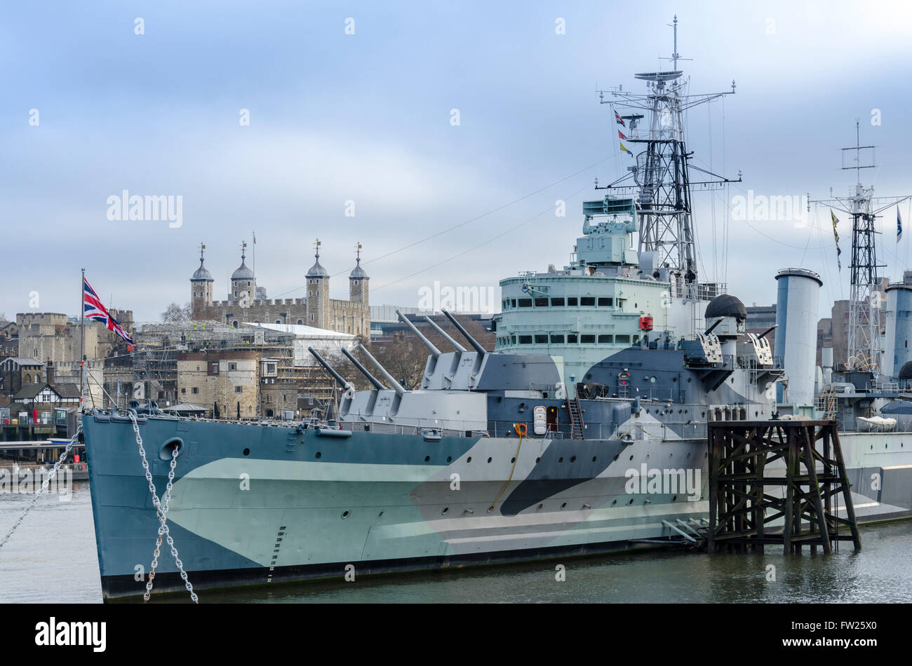 HMS Belfast with Tower of London in background. London, UK - Stock Image