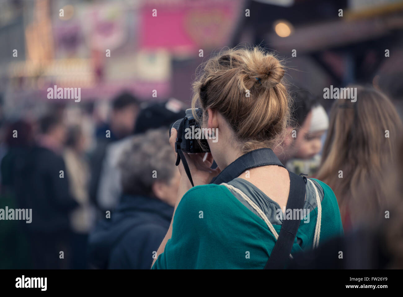 girl taking pictures at Oktorberfest - Stock Image