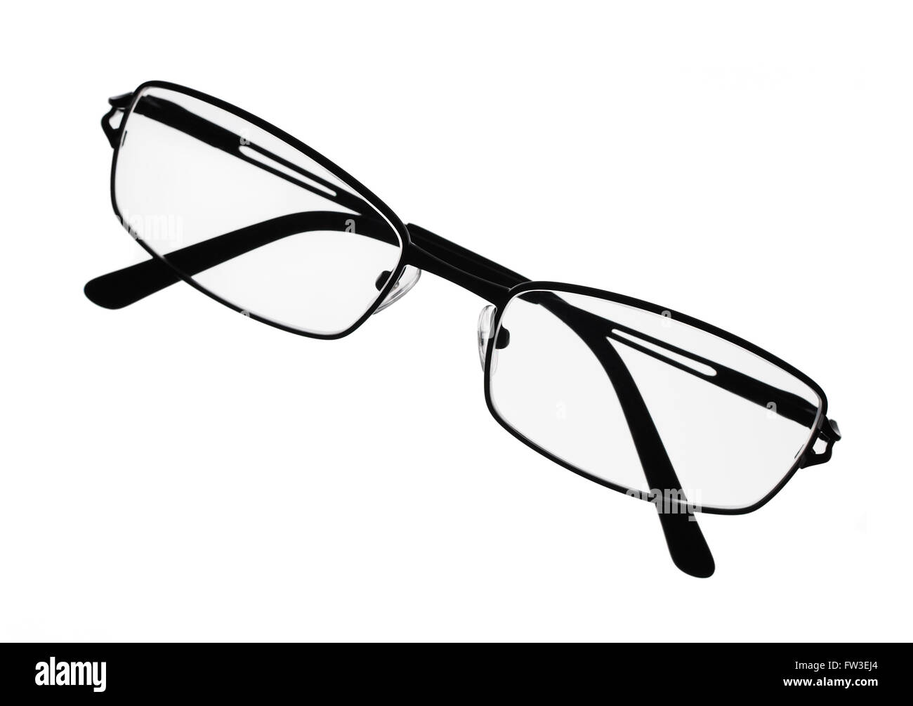 Reading eyeglasses over white surface - Stock Image