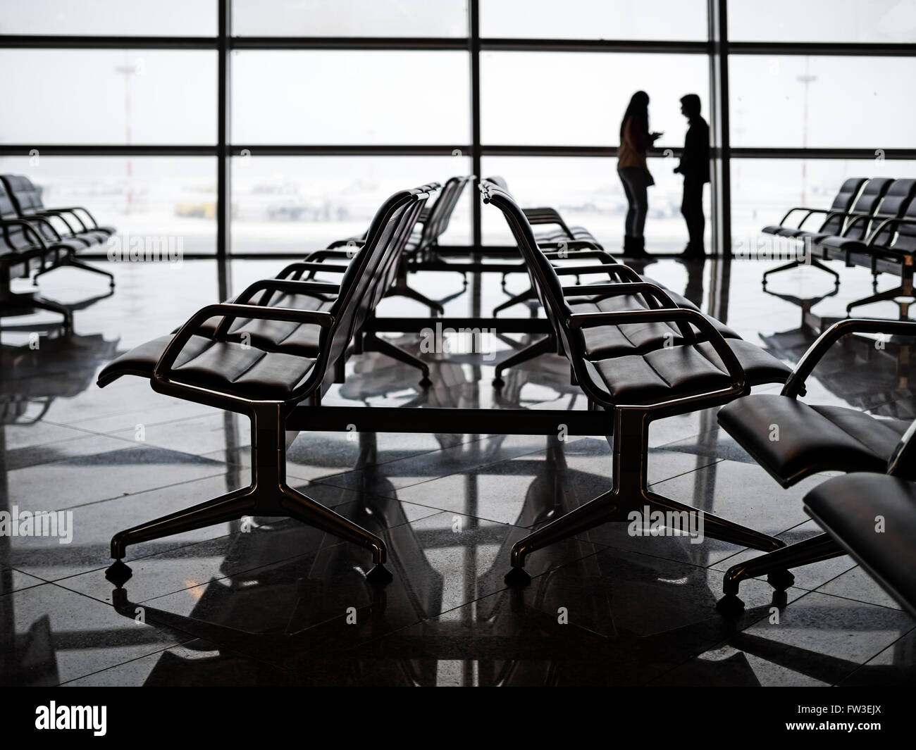 Empty seats at the departure lounge in the Airport, shallow depth of field - Stock Image