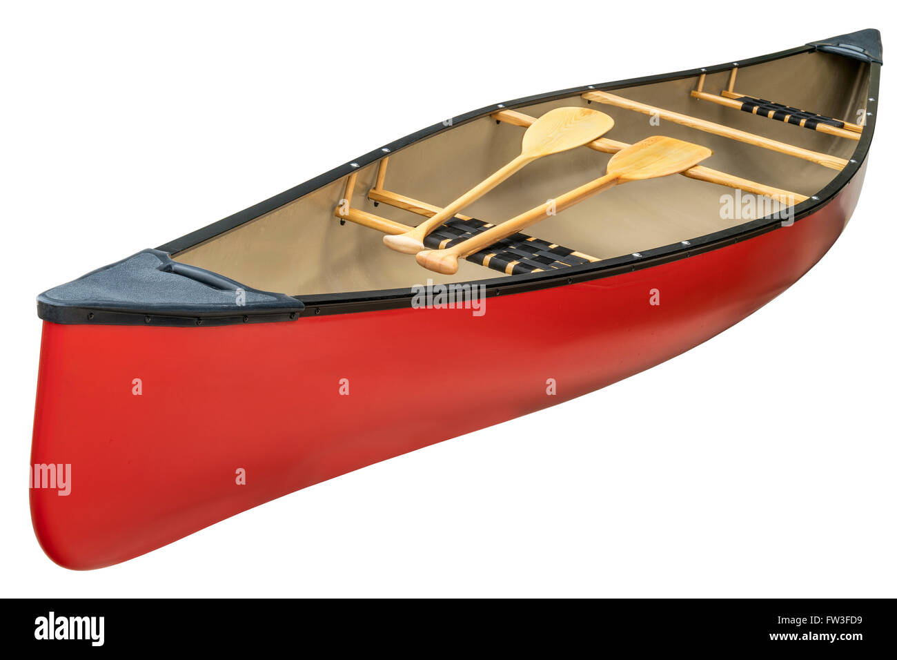 red canoe with a pair of wooden paddles,  isolated on white - Stock Image