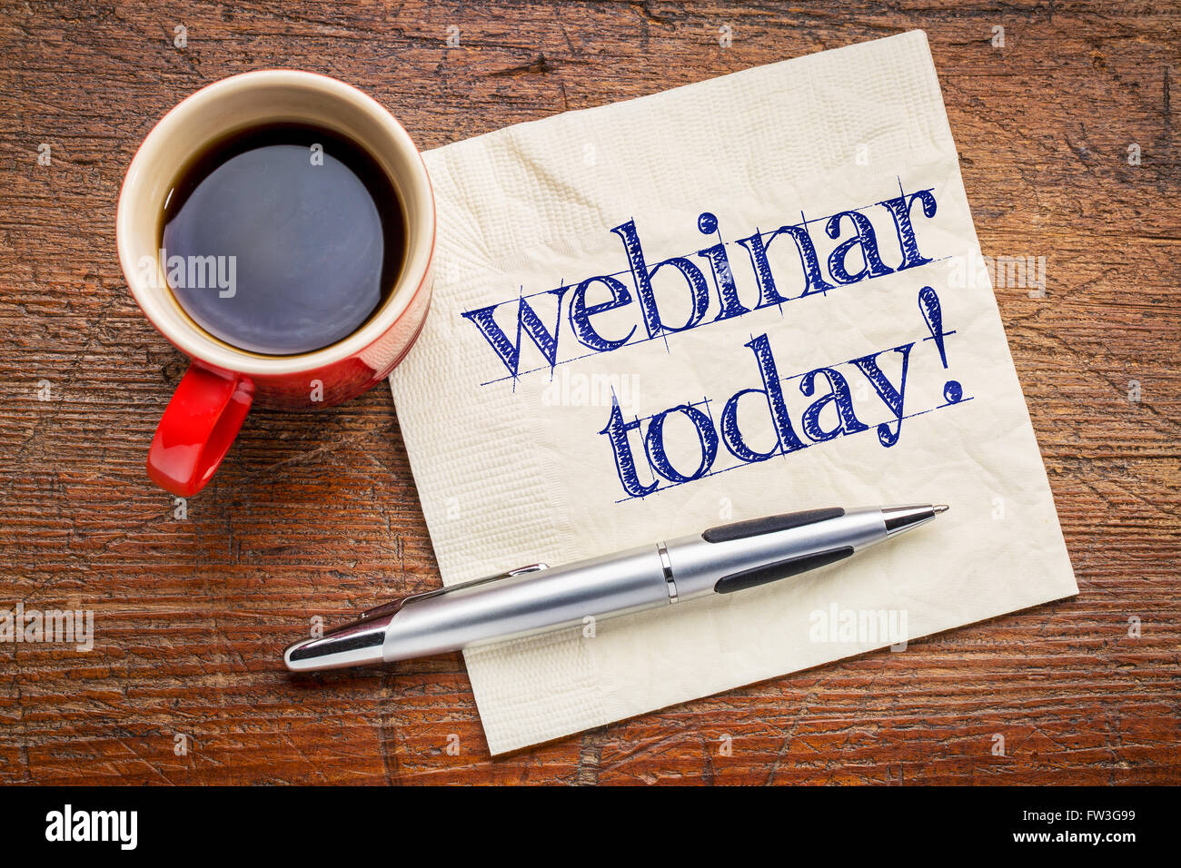 webinar today reminder - handwriting on a napkin with cup[ of coffee - Stock Image