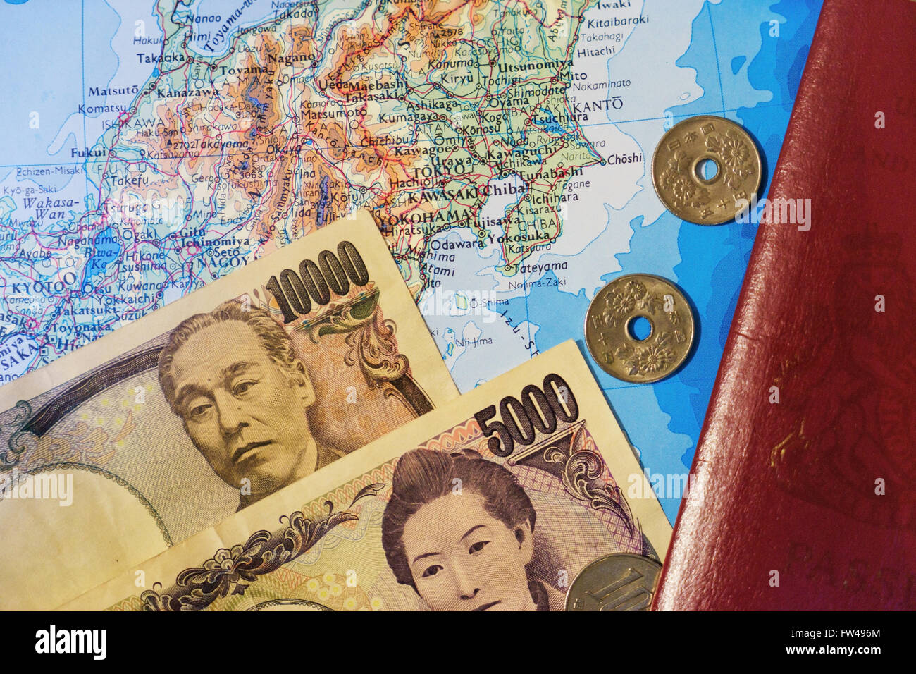 Japanese map, money and passport for travelling. - Stock Image