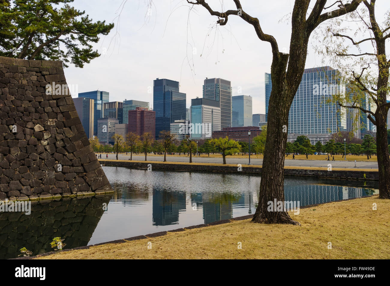 The moat and gardens at the Imperial Palace against the city skyline, Tokyo, Japan. Stock Photo