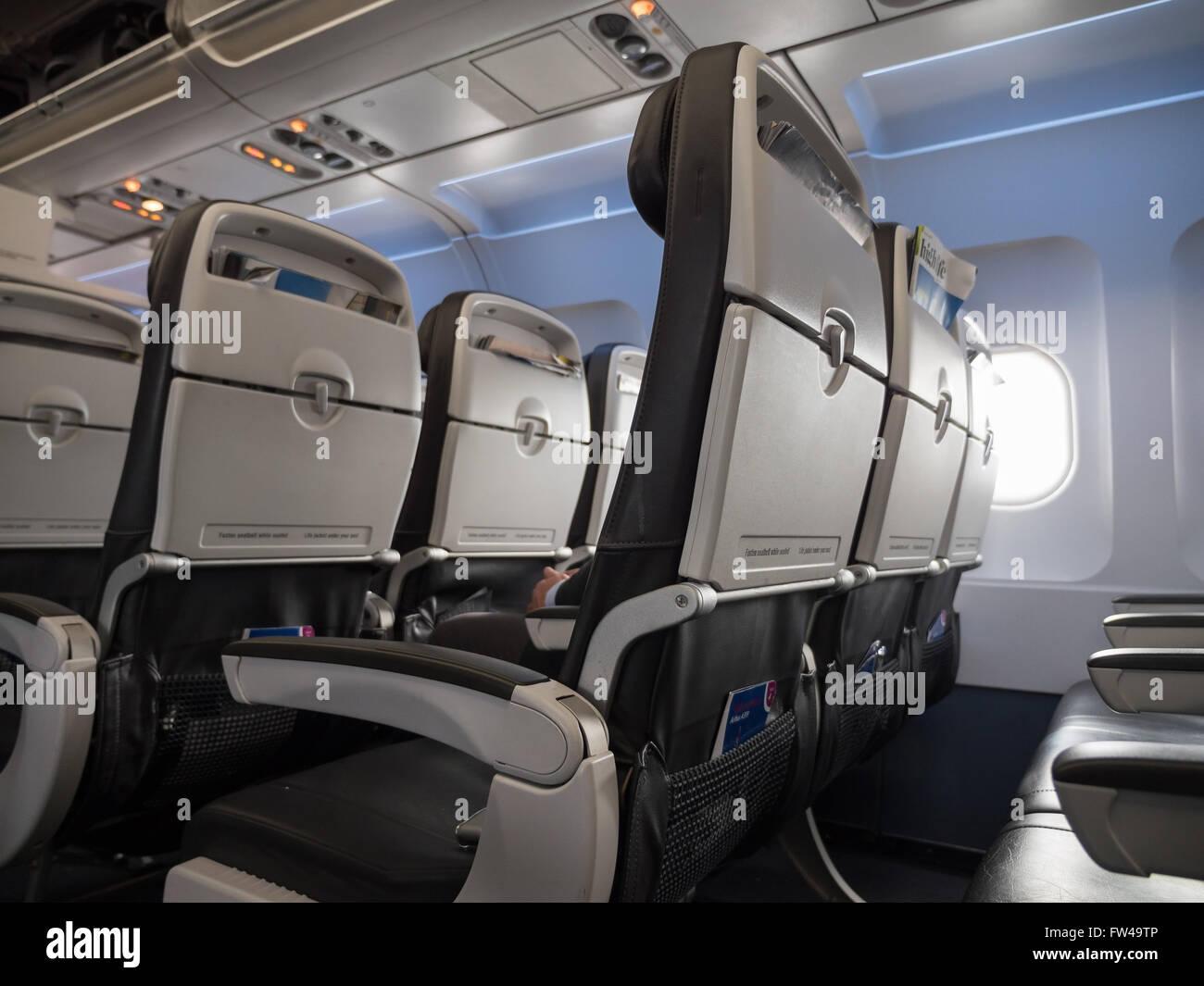 Empty economy seats on an aeroplane. - Stock Image