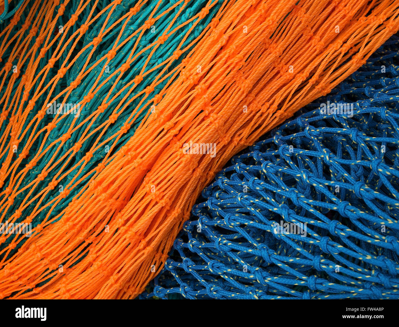 A colourful new nylon fishing (trawl) net. - Stock Image