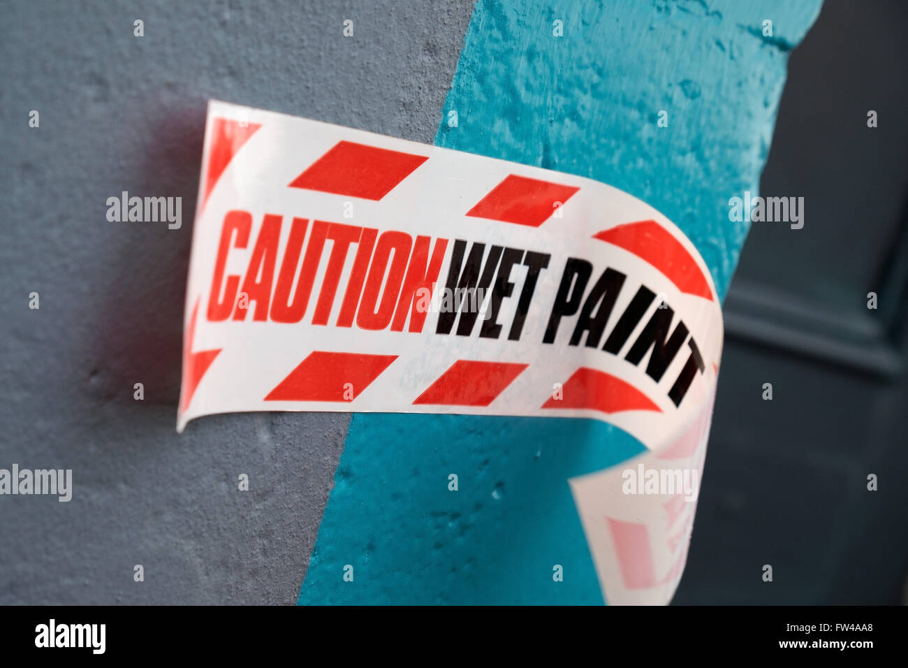 A caution wet paint warning notice. - Stock Image