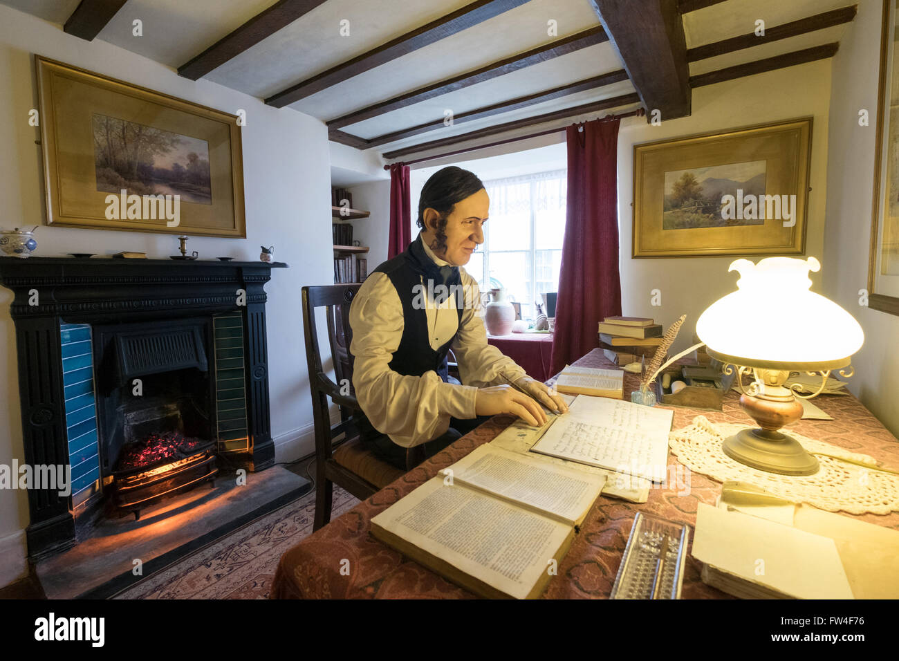 Model of Author Charles Kingsley writing in his study at the Kingsley Museum in Clovelly village, Devon - Stock Image