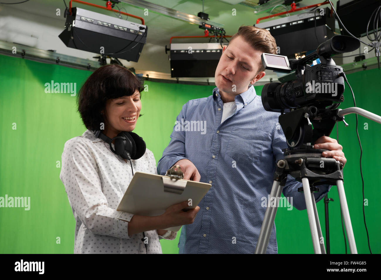 Cameraman And Floor Manager In Television Studio - Stock Image