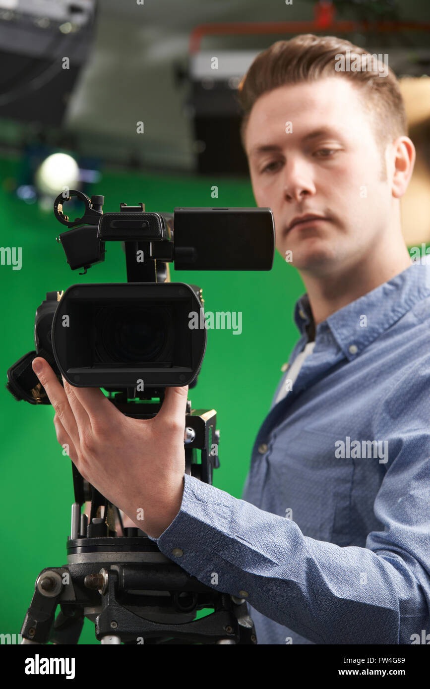 Male Camera Operator In Television Studio - Stock Image