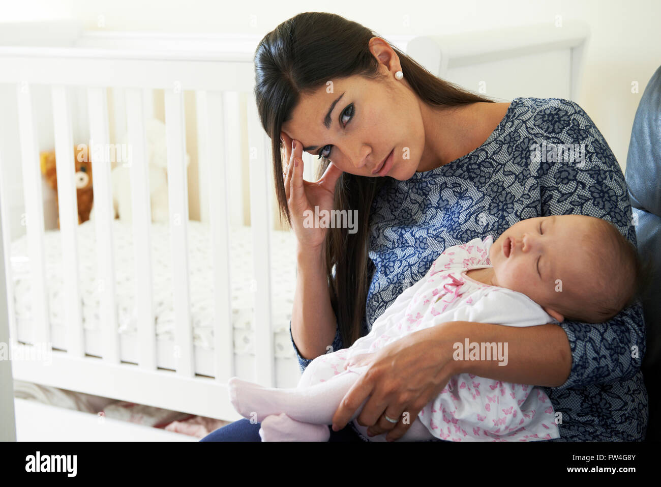 Tired Mother Suffering From Post Natal Depression - Stock Image
