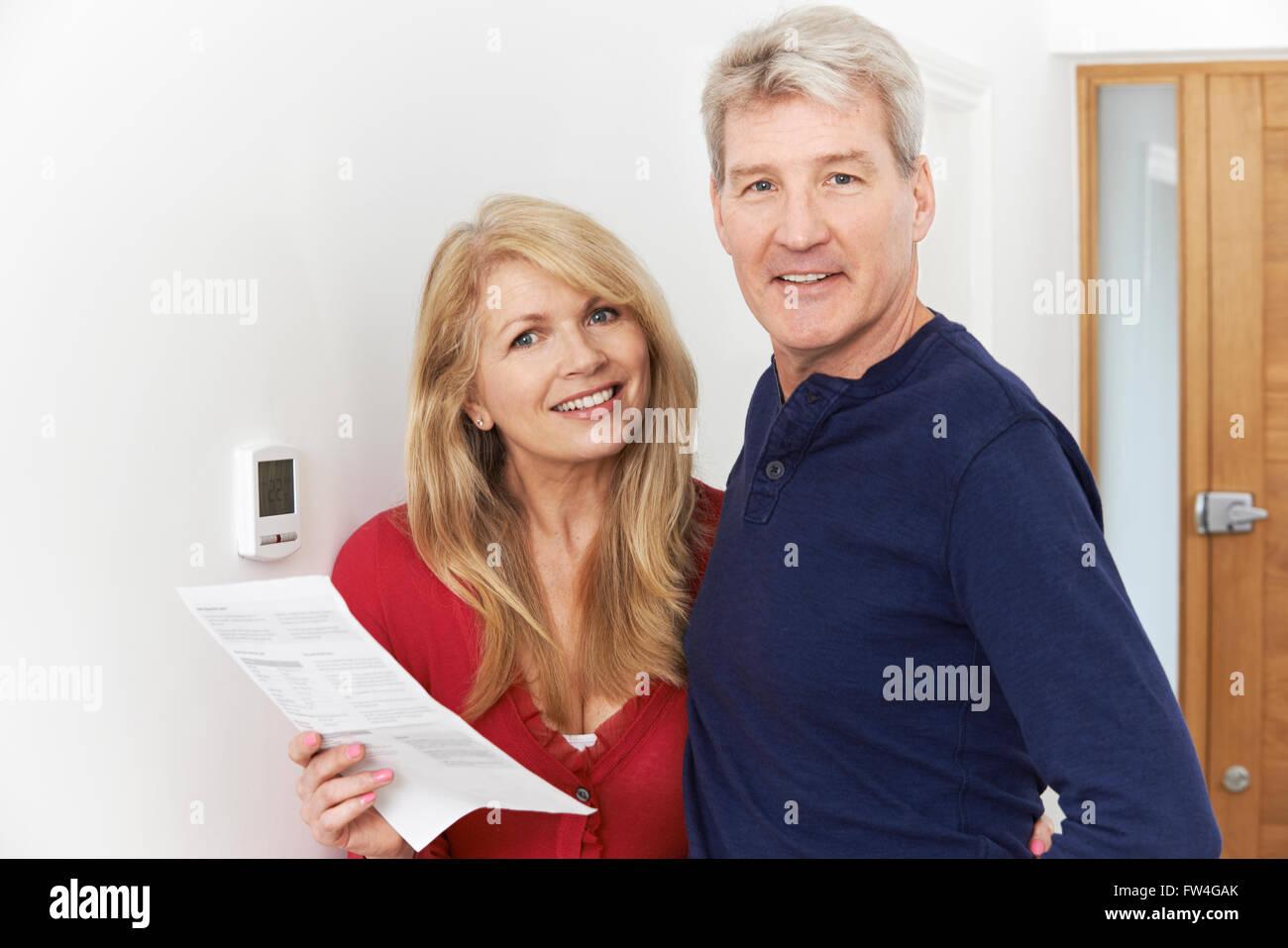 Mature Couple Saving Money On Domestic Heating Bills - Stock Image