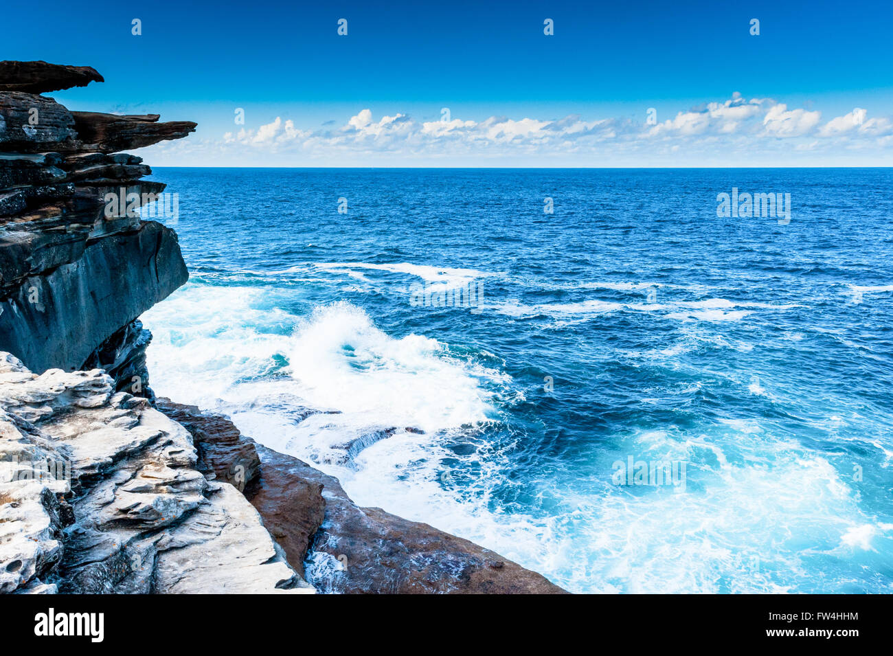 Rock formations eroded by wind and water along the Bondi to Coogee coastal cliff top walk in Sydney's Eastern suburbs Stock Photo