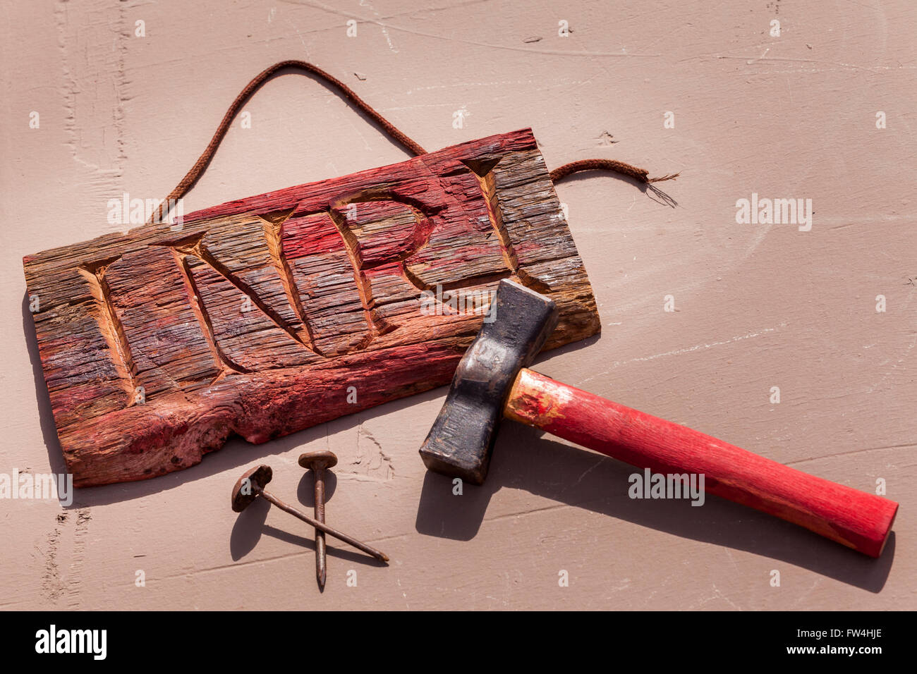 Wooden carved INRI placque with hammer and nails props for the Passion Play, Adeje, Tenerife, Canary Islands, Spain. - Stock Image
