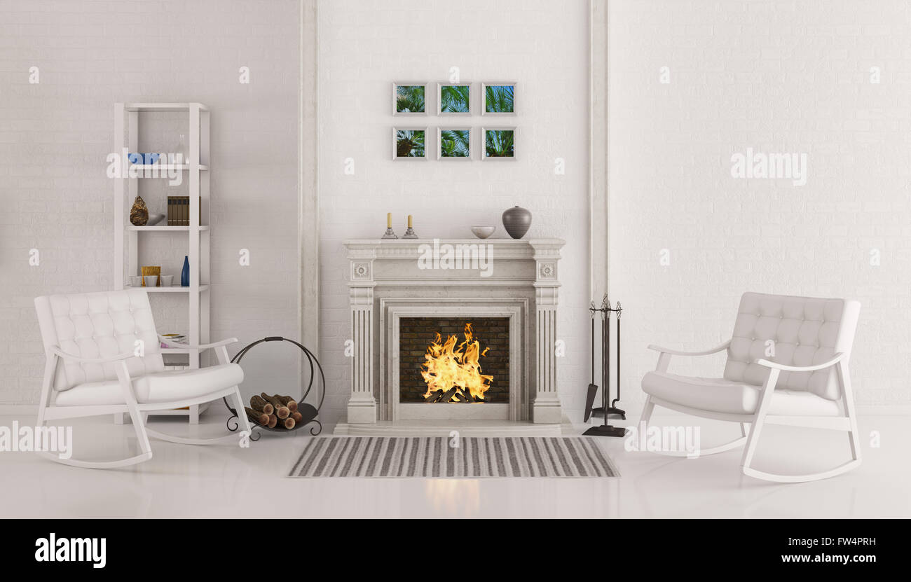 Interior of white living room with fireplace and two rocking chairs ...