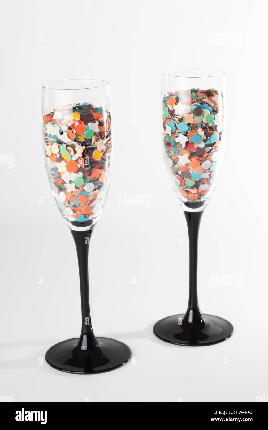 Champaign glasses with confetti, isolated on white background - Stock Image