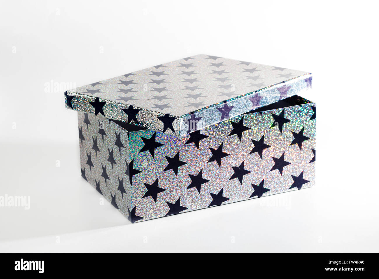 Giftbox with glitters and stars, isolated on white background - Stock Image