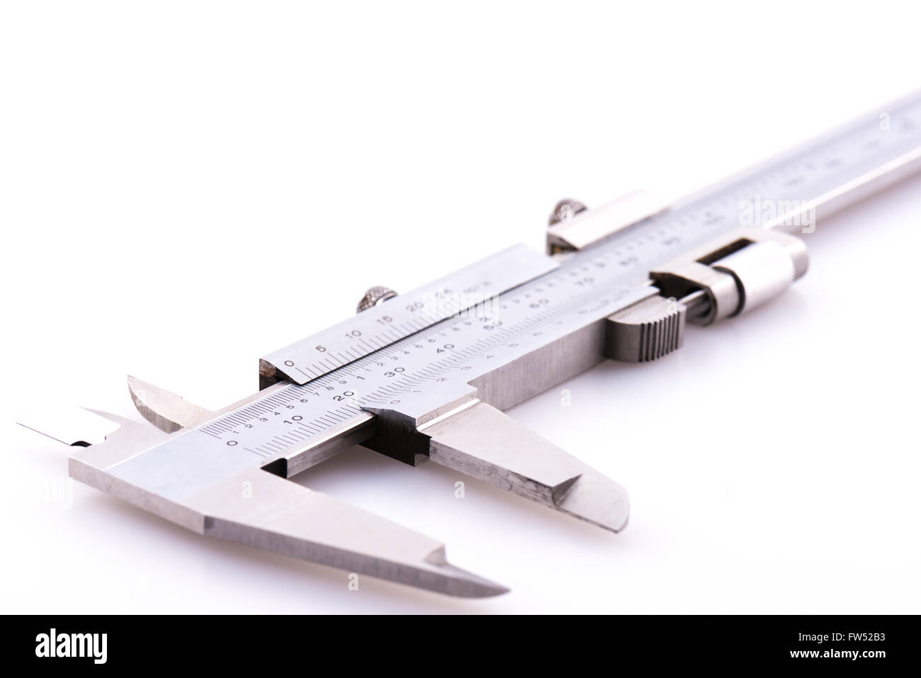Close up of a set of vernier calipers on a white background - Stock Image
