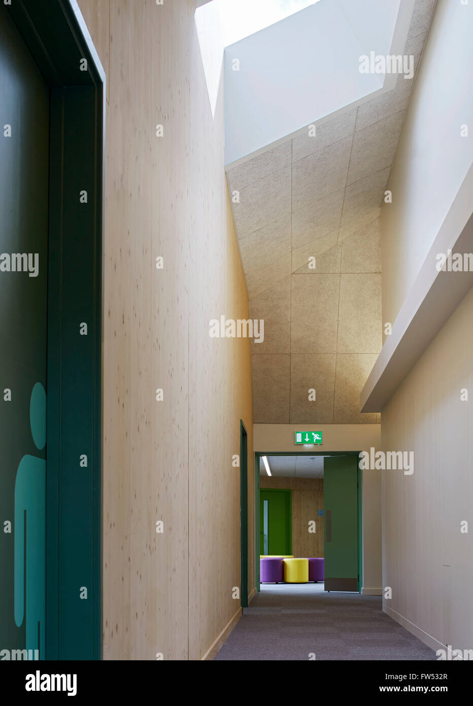 Corridor with skylight leading to breakout space. Davenies School, Beaconsfield, United Kingdom. Architect: DSDHA, - Stock Image