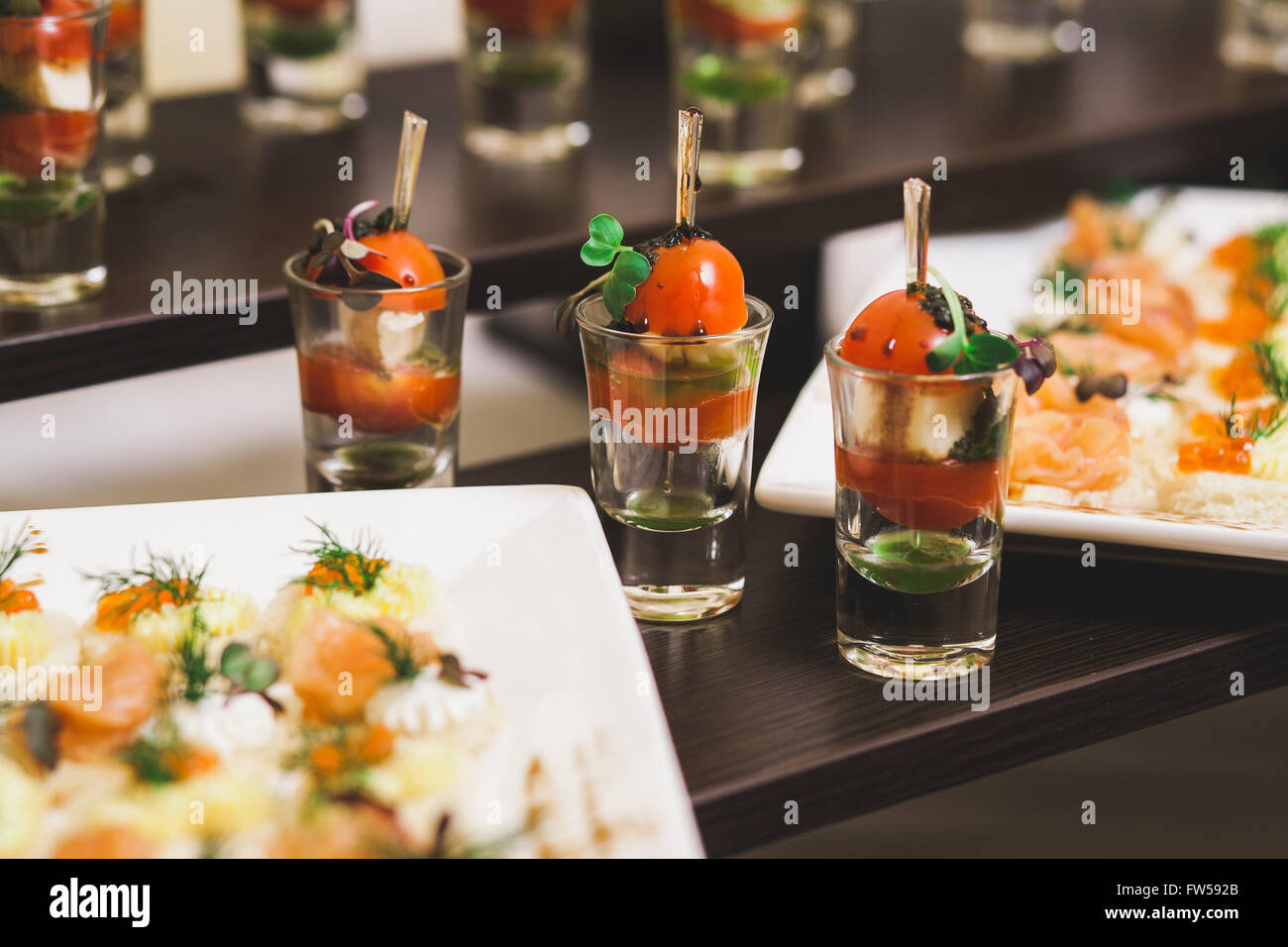Catering for party. Close up of sandwiches, appetizers and fruit. Canapes - Stock Image
