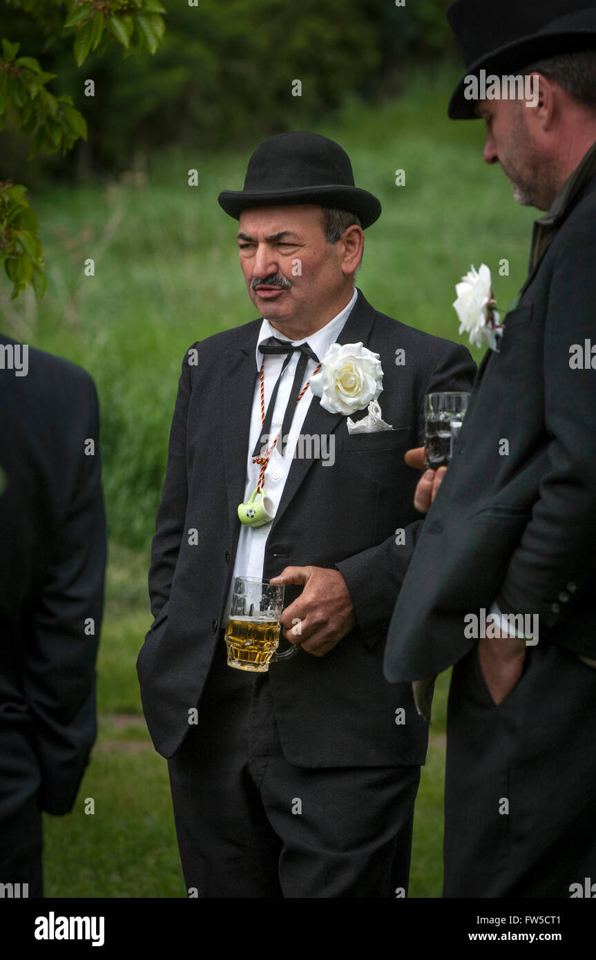 Unusual costumes are traditional. Saxony-Anhalt men celebrating 'Manner Tag' or Fathers Day at the Petersberg - Stock Image