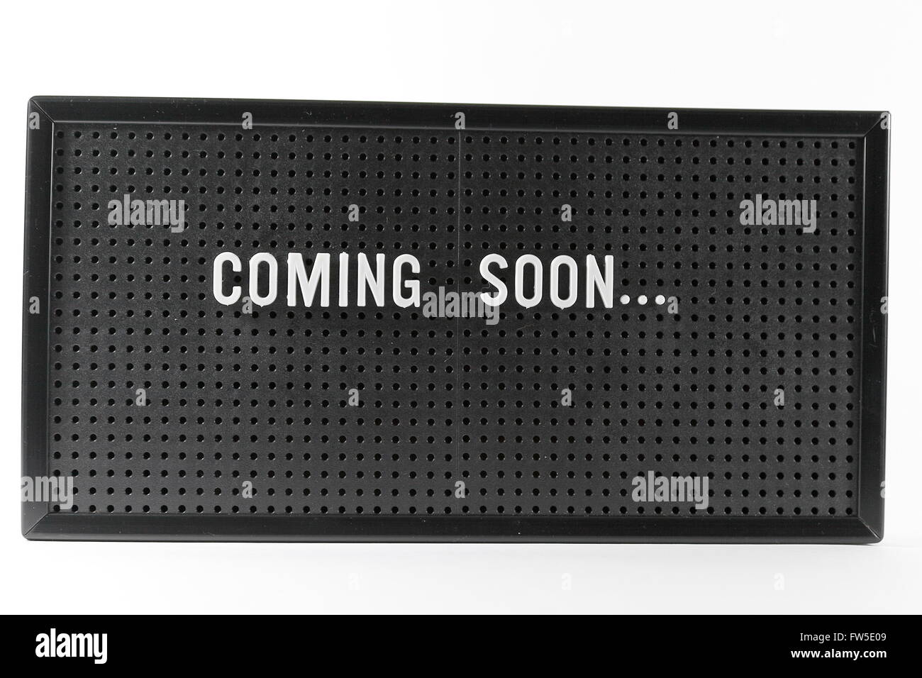 A pegboard style noticeboard with interchangeable letters. - Stock Image