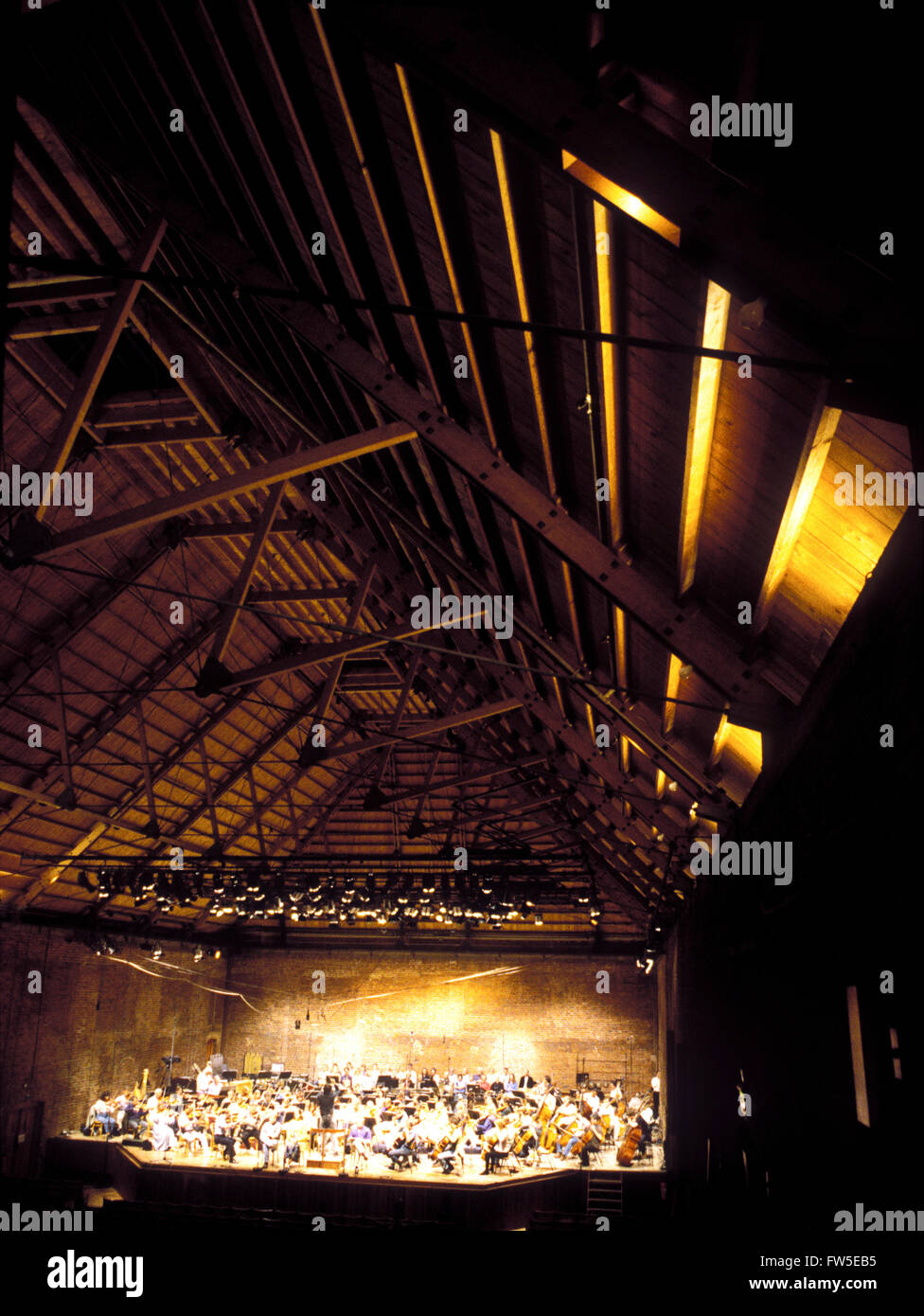BRITTEN, B.  Snape Maltings Concert Hall Suffolk.  Interior, with orchestra rehearsing.  1999. - Stock Image