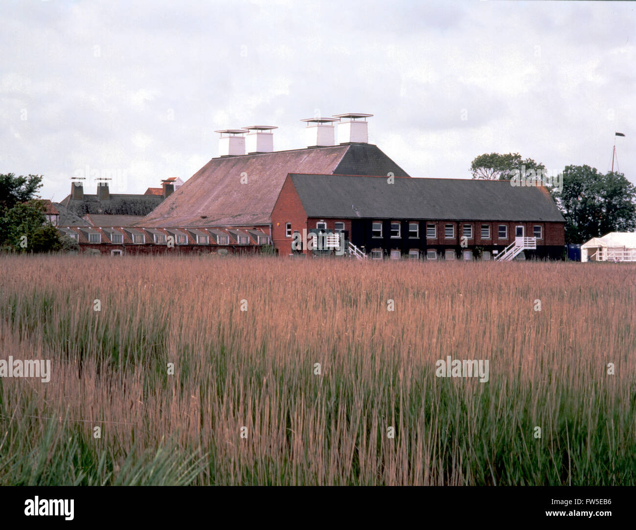 BRITTEN  - SNAPE MALTINGS. Exterior of Snape Maltings Concert Hall.  Promenade from reed beds. - Stock Image