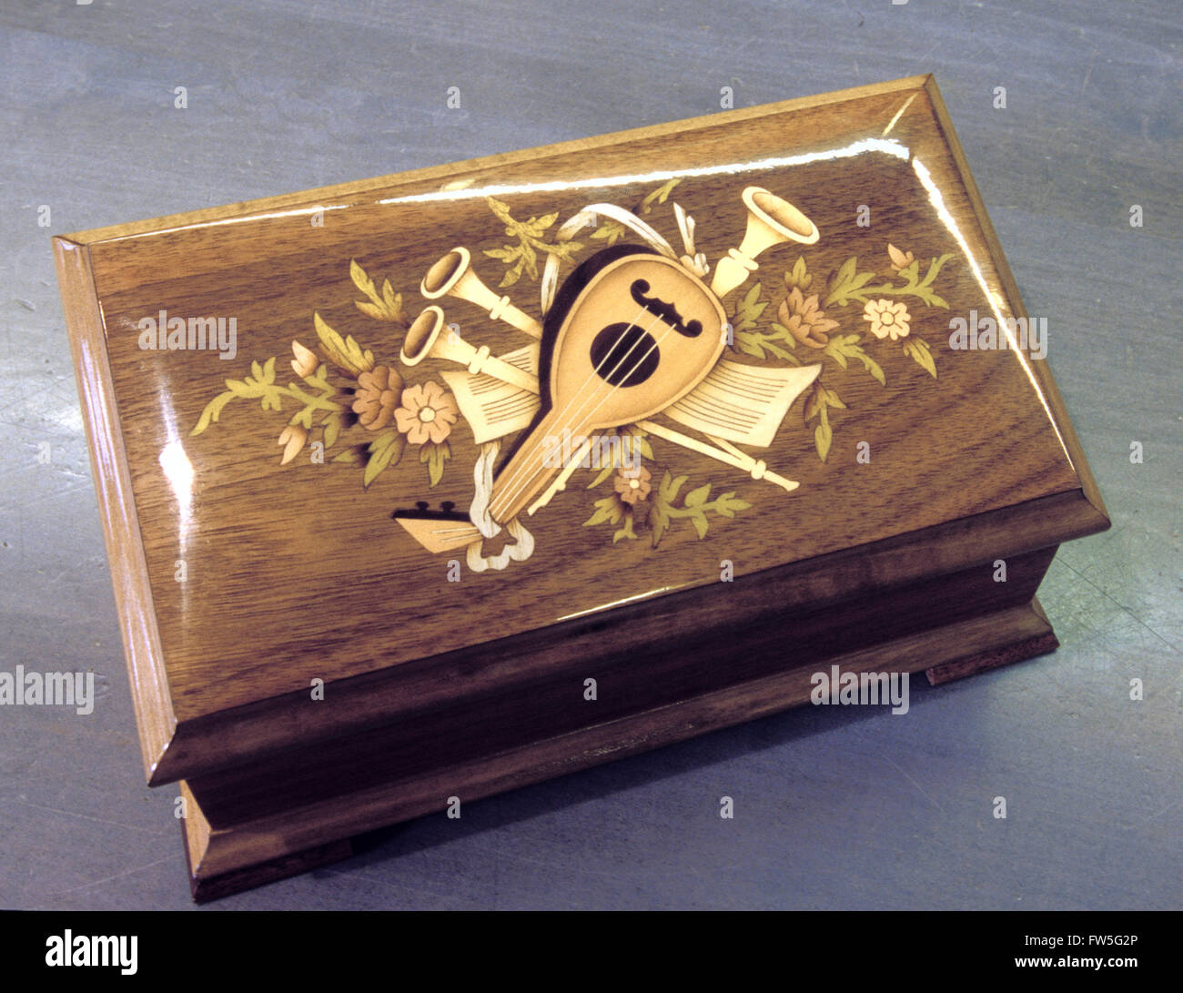 Miniature music box - close up of a closed rectangular music box showing inlaid woodwork. Italian design showing - Stock Image