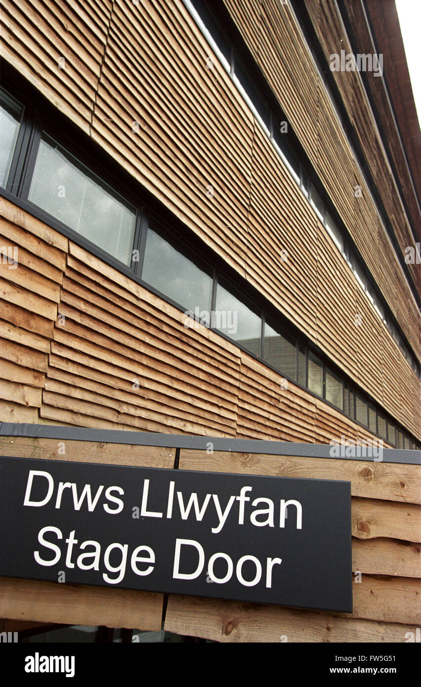 Cardiff Millennium Centre - exterior view showing the stage door sign in English and Welsh Cardiff Bay Wales. Home to Welsh & Cardiff Millennium Centre - exterior view showing the stage door ...