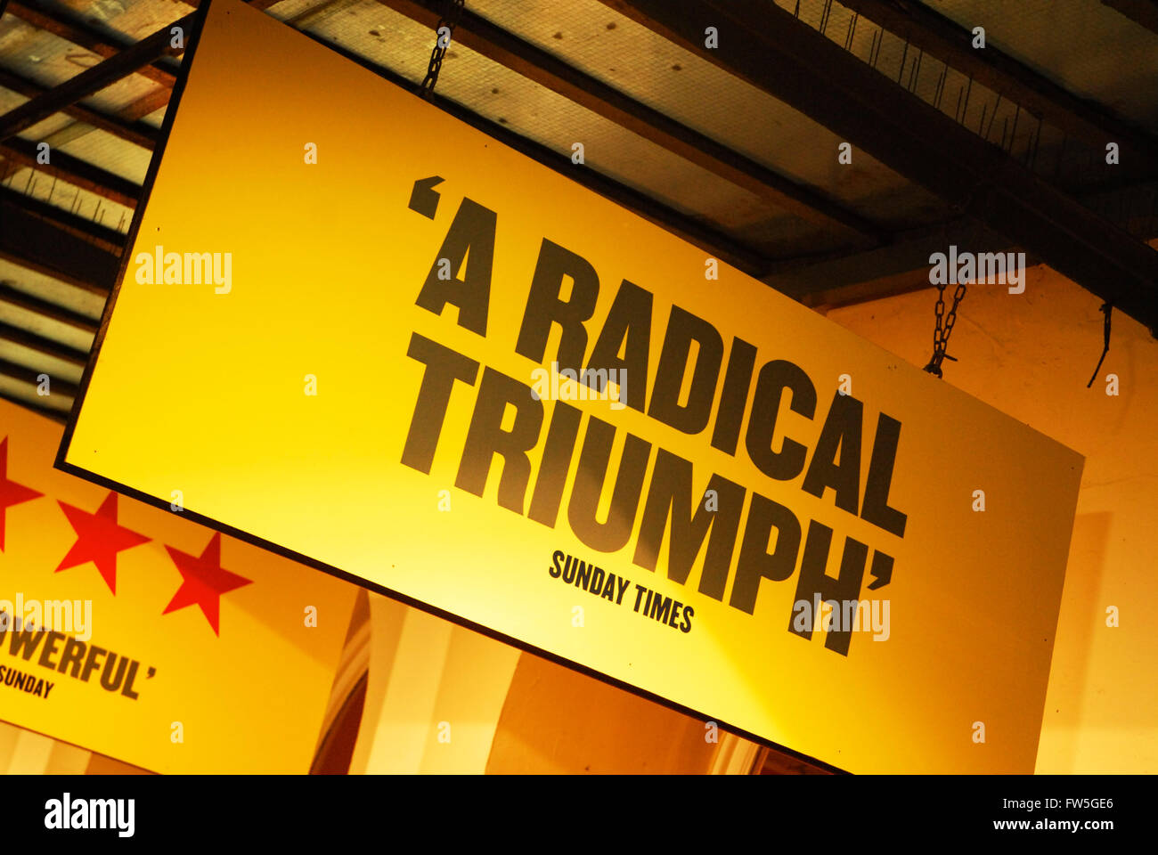 Theatre Sign - (A radical triunph) West End Theatre, London. - Stock Image