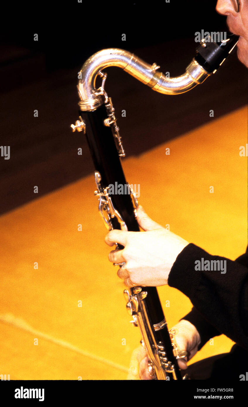 Bass Clarinet. (Mouthpiece, neck & upper half being played - mouth/hand) - Stock Image
