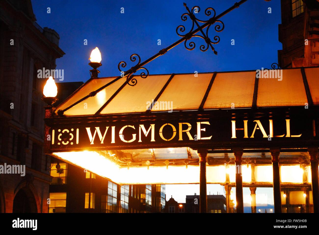 Wigmore Hall, London's premier recital venue, portico illuminated against evening sky. Wigmore Street, London - Stock Image