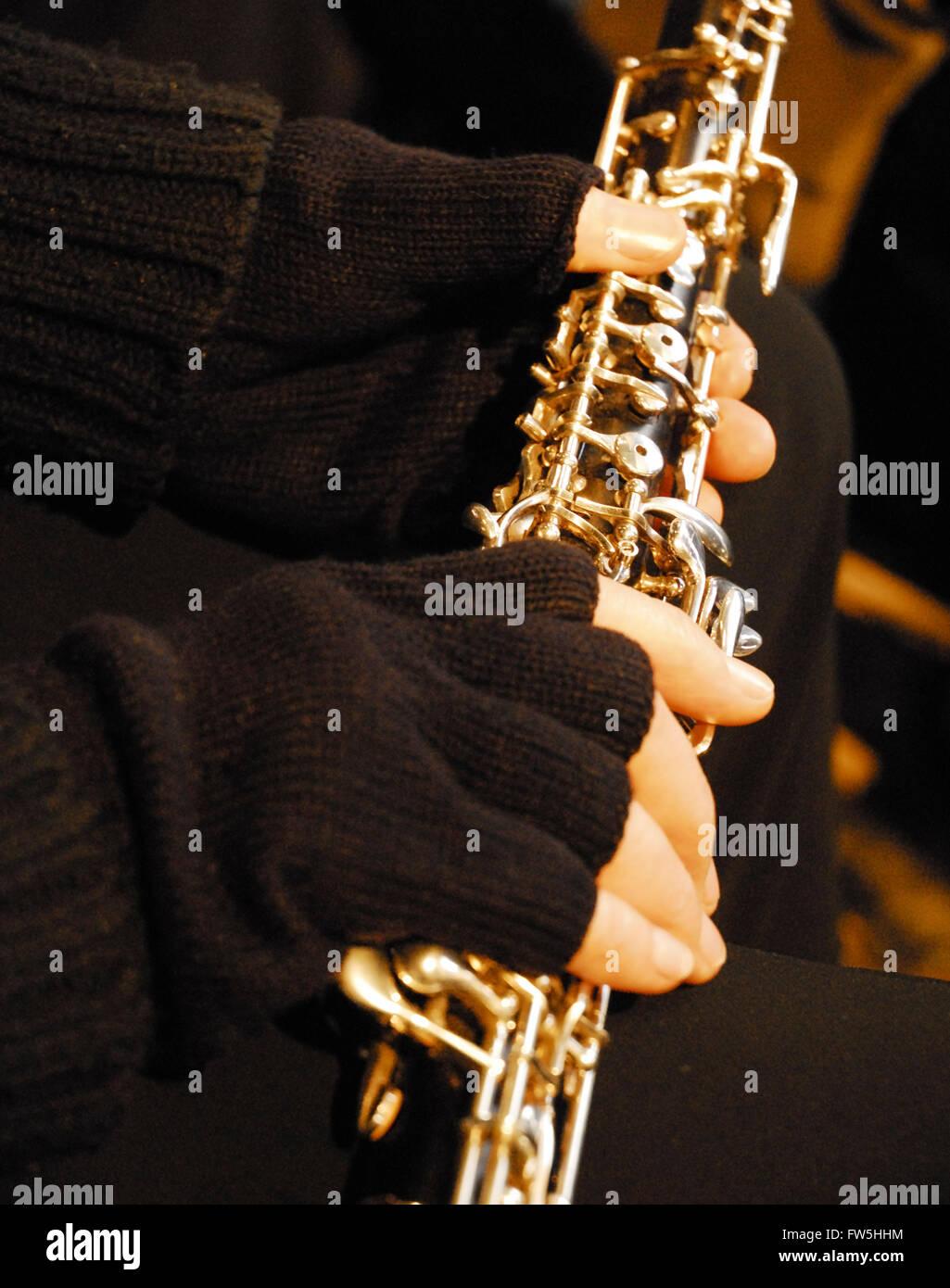 Cold concerts, black half-finger mitts to warm hands of oboist in cold concerts - Stock Image