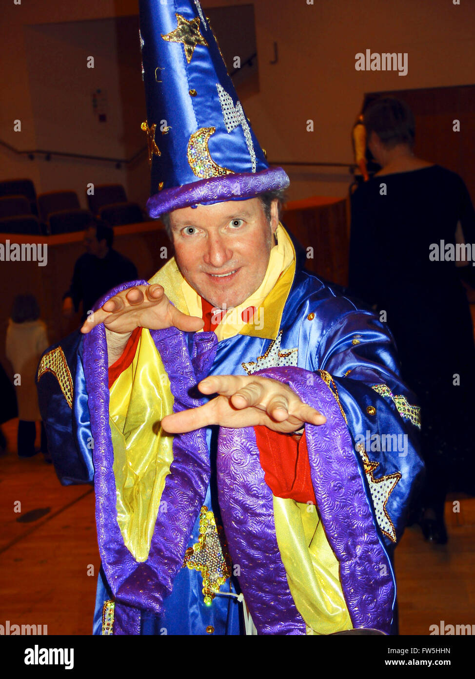 Alistair Malloy, as wizard, introducing children's concert, compère, presenter, percussionisst, BBC Concert - Stock Image