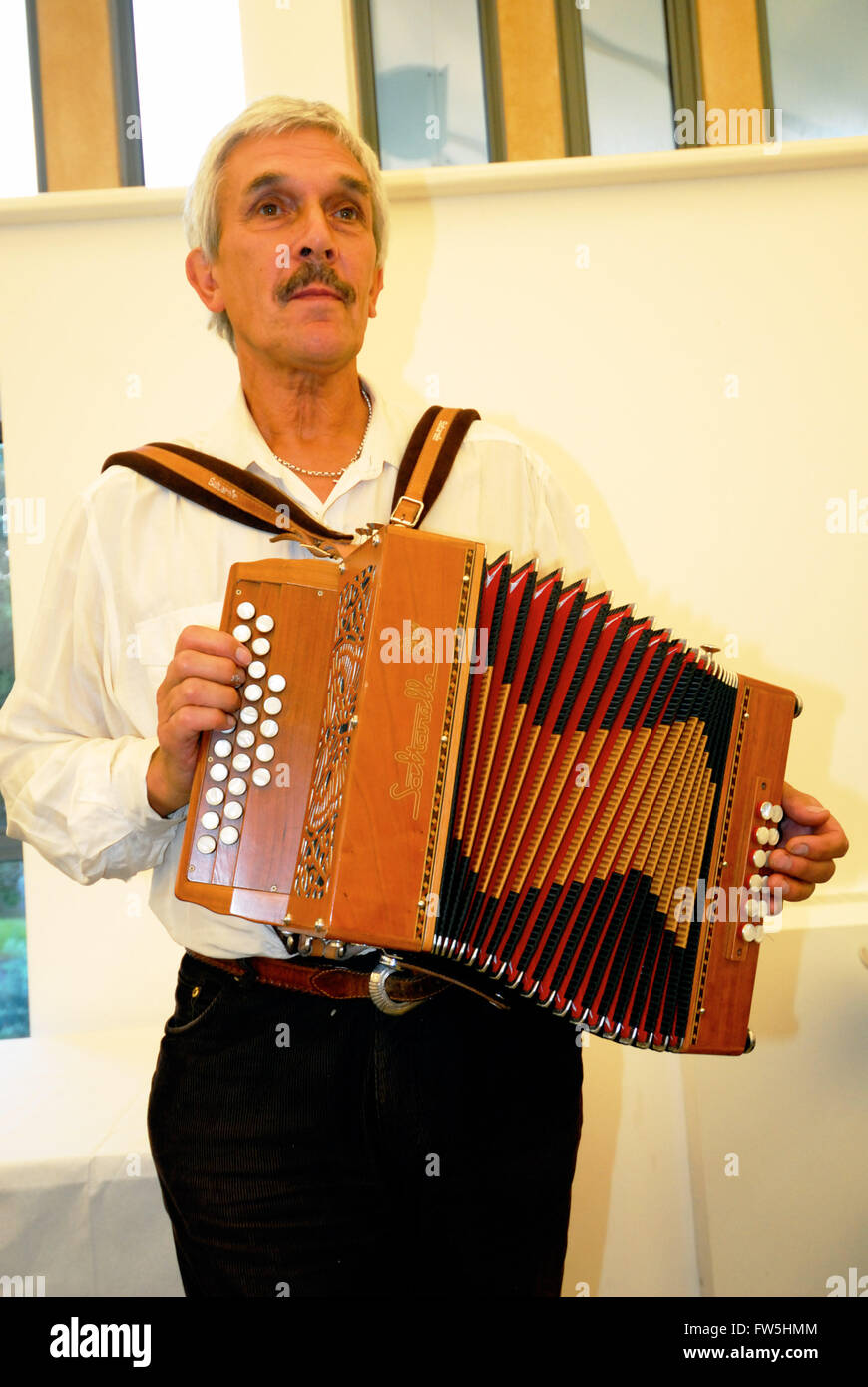 Alan Wheeler, of Cotillion folk group, West Sussex, playing the melodion (English folk concertina) 'in D and - Stock Image