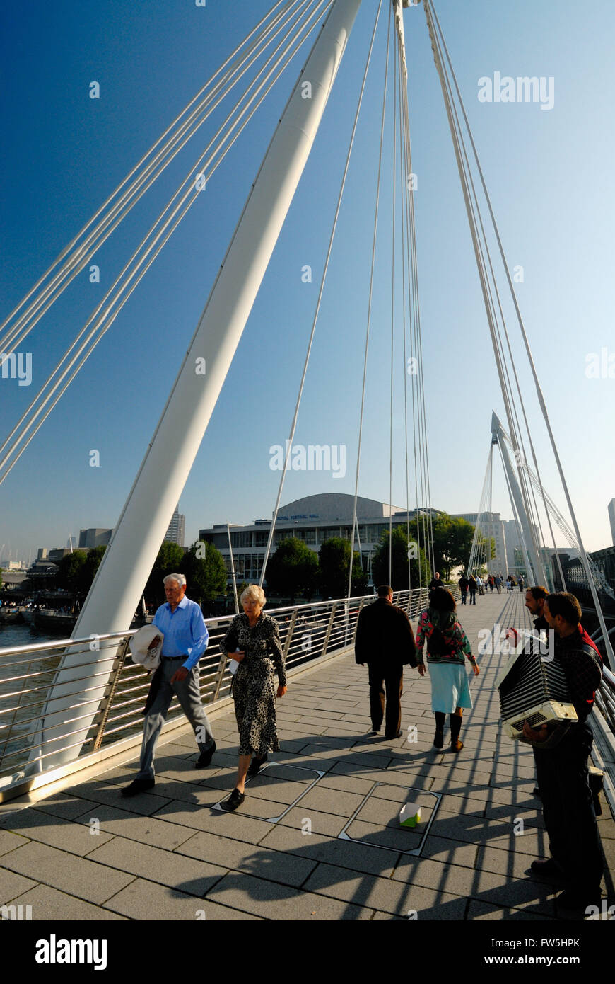 new Hungerford Bridge, foot bridge linking London's South Bank with the West End, showing Royal Festival Hall, - Stock Image