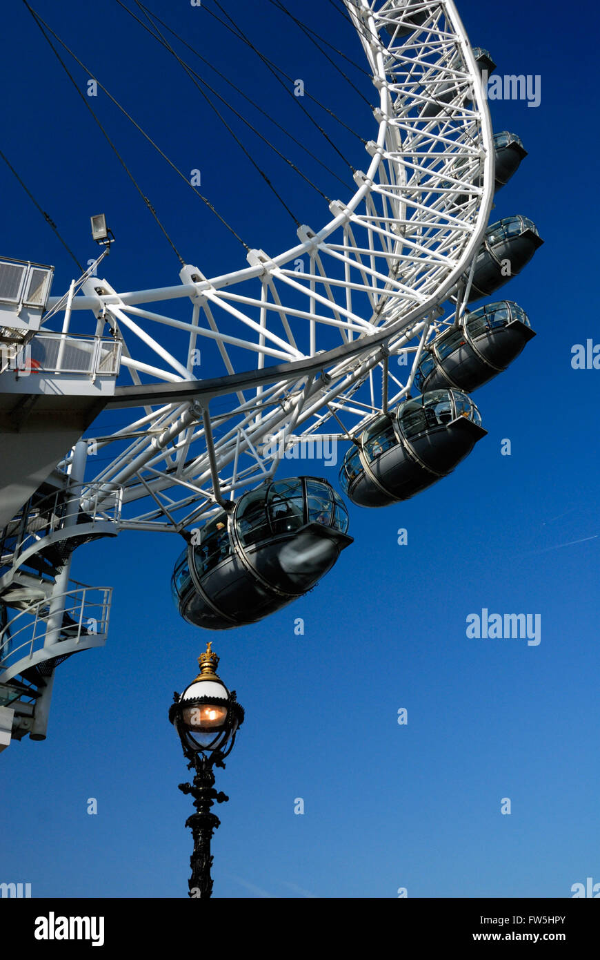 London Eye, millenium wheel, with old fashioned lamp post, near Royal Festival Hall, RFH, concert hall, along the - Stock Image