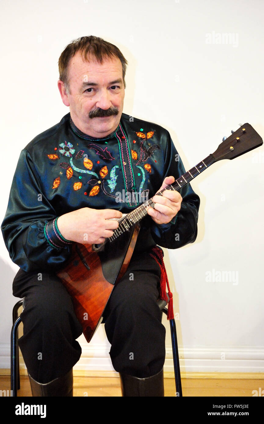 Balalaika, Russian three-stringed plucked instrument, played by Bibs Ekkel, Balalaika soloist, director, Russian - Stock Image