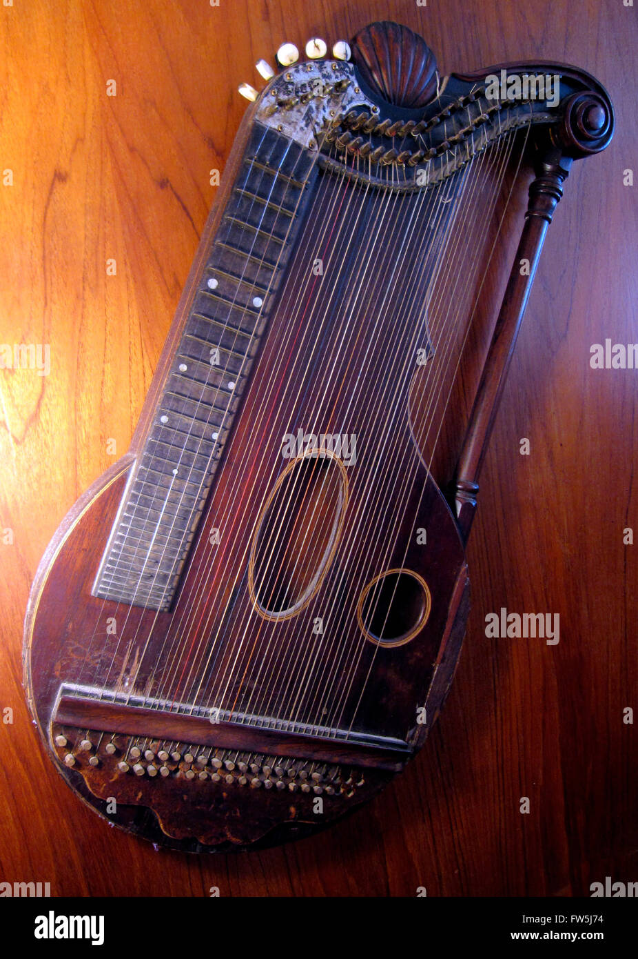 Austrian concert zither, mid nineteenth century. 5 stopped strings and 32 unstopped, plucked string instrument often - Stock Image